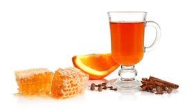 Tè, spezia, arancio e miele fotografie stock