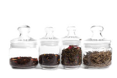 Tè in vasi di vetro: puer del latte, tè indiano, oolong Fotografie Stock