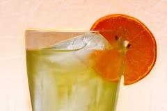Tè verde con la fetta arancione Immagini Stock