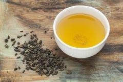 Tè verde della polvere nera Fotografie Stock