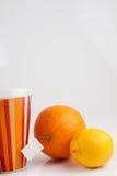 Té con el limón y la naranja Foto de archivo libre de regalías