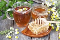 Té con la miel Imagen de archivo