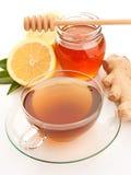 Té con la miel, el limón y el jengibre Imágenes de archivo libres de regalías
