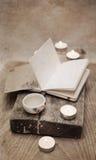 Té de China, cuaderno, velas Imágenes de archivo libres de regalías