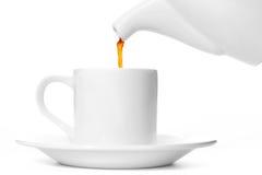 Tetera y una taza de té Imagen de archivo libre de regalías