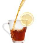 Té en la taza de cristal con el limón Foto de archivo