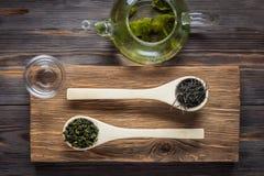 Té verde del chino tradicional de diversa fermentación y del arroz fotografía de archivo