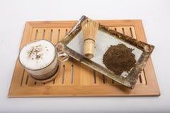 Té y polvo calientes del té Fotos de archivo