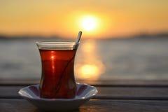 Té y puesta del sol Imagen de archivo libre de regalías