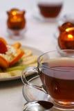Té y vela con la ensalada de fruta Imagen de archivo libre de regalías