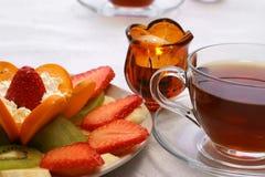 Té y vela de las frutas Imagenes de archivo
