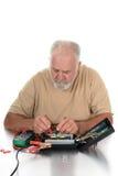 Técnico Using Testing Equipment Fotografía de archivo libre de regalías