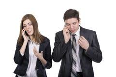 Télécommunication gens d'affaires d'homme et femme Photo libre de droits