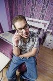 Téléphone à la chambre à coucher Photo libre de droits
