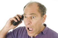 Téléphone émotif de Moyen Âge d'homme Image libre de droits
