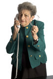 Téléphone aîné de femme Image stock