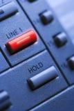 Téléphone avec la ligne une bouton de Lit Photographie stock