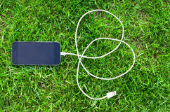 Téléphone avec le câble d'USB Photos stock