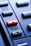 Téléphone avec le volume de Lit vers le haut du bouton Image libre de droits