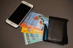 Téléphone, billets de banque et portefeuille Photo stock