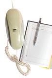 Téléphone, calendrier et crayon lecteur Images libres de droits