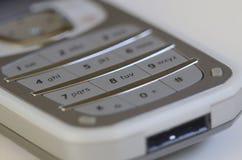 Téléphone cellulaire de chiquenaude Photographie stock libre de droits