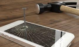 Téléphone cloué à la table avec le marteau Images stock