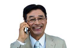 Téléphone d'homme d'affaires appelle asiatique de sourire Photographie stock libre de droits