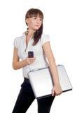 téléphone d'ordinateur portatif de femme d'affaires Photographie stock libre de droits