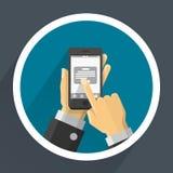Téléphone dans des mains Image libre de droits
