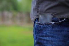 Téléphone dans la poche Photographie stock libre de droits