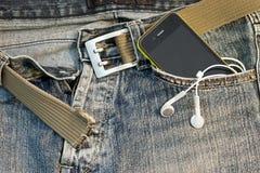 Téléphone dans la poche Image stock