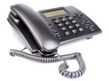 Téléphone de bureau au-dessus de blanc Photos libres de droits