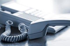 Téléphone de bureau outre de crochet photo libre de droits