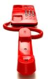 Téléphone de bureau rouge lumineux Photos libres de droits
