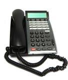 Téléphone de bureau sur le blanc Photographie stock
