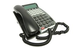 Téléphone de bureau sur le blanc Photo libre de droits