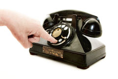 Téléphone de composition de main Photographie stock