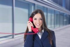 Téléphone de femme d'affaires Photos libres de droits