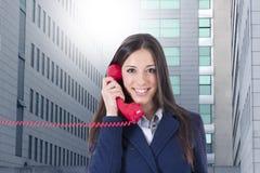 Téléphone de femme d'affaires Photos stock