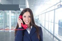 Téléphone de femme d'affaires Image stock