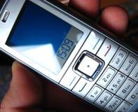téléphone de fixation de main image libre de droits