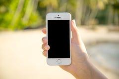 Téléphone de participation de main Photos stock
