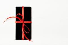 Téléphone emballé comme cadeau Photo libre de droits