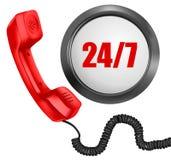 Téléphone et 24/7 bouton. 24 heures en jour Images libres de droits