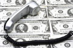 Téléphone et argent Images stock