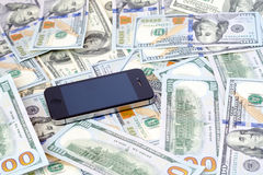 Téléphone et argent liquide Photographie stock