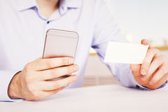 Téléphone et carte de visite professionnelle de visite Photo libre de droits