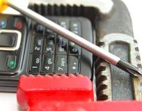 Téléphone et clé réglable Photos libres de droits