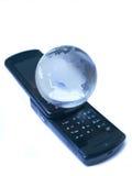 Téléphone et globe Photos libres de droits